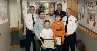 Cooper and Ryder Fiske-Kneafsey, their parents, and Lower Merion Fire Department officials