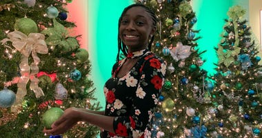 Grace admires the Christmas trees at the KYW Newsradio broadcast center