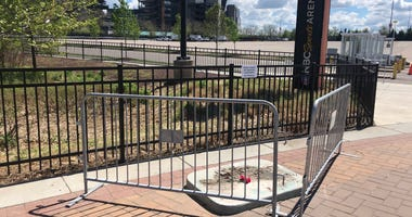 Where the statue of the late singer Kate Smith once stood at the Sports Complex in South Philadelphia there is now an empty spot with three flowers.