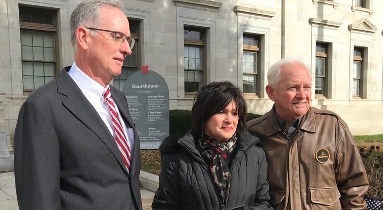 Delaware County Prosecutor Daniel McDevitt, with Rosann DeRsa and Richard DeRosa, parents of Deana Eckman.