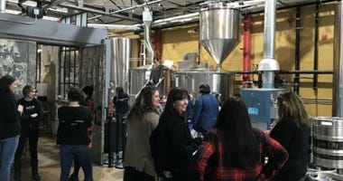 A group of women in pink boots spent their International Women's Day making beer at a brewery in the Callowhill section of Philadelphia in the name of education.
