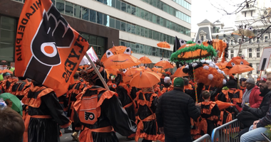 Froggy Carr club dressed with a Flyer's theme during the Mummer's Parade.