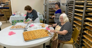 Women baking as they get ready for the Greek Agora Festival in Cherry Hill.