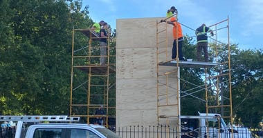 Crews box up the Christopher Columbus statue in South Philadelphia