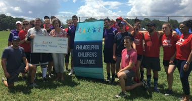 About two dozen insurance companies participated in a charity softball tournament to benefit the Philadelphia Children's Alliance.