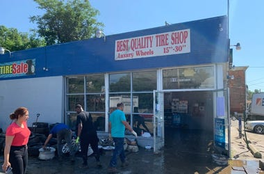 Cleaning up the aftermaths of the flood at Best Quality Tire Shop in Darby