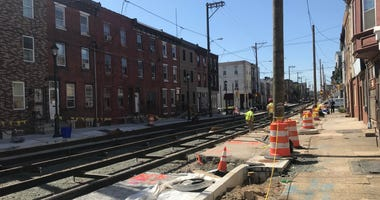 A crew working to install trolley tracks along Richmond St.