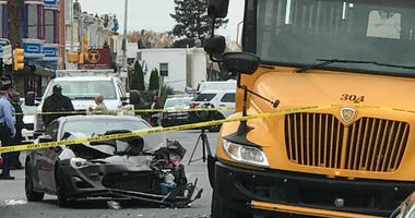 A car slammed into the back end of a parked school bus in West Philadelphia.