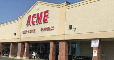 Shoppers at the East Passyunk Avenue Acme react after learning that one of the store's workers has hepatitis A.