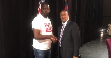 Community activist Darryl Shuler shakes hands with Philadelphia Police Commissioner Richard Ross.