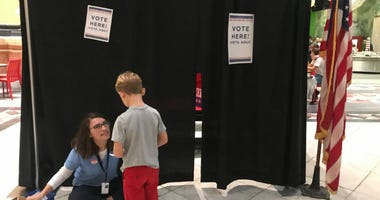 A young museum-goer gets ready to cast his ballot for his favorite toy at the Please Touch Museum.