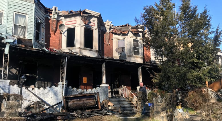 The site of a fire along Walnut Street near 61st Street in West Philadelphia. Eight rowhomes were damaged, displacing more than 20 residents.