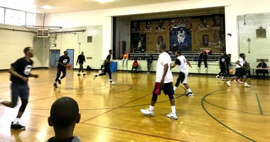 """Young boys and men from all walks of life united to take part in the """"Play 4 Peace"""" basketball game in East Germantown."""
