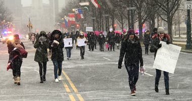 Despite bitter temperatures and snow, thousands attended the Women's March on the Benjamin Franklin Parkway Saturday.