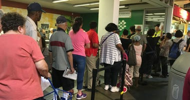 Low-income senior citizens stood in long lines at Reading Terminal Market for free produce vouchers, highlighting the sheer number of Philadelphians who suffer from food insecurity.