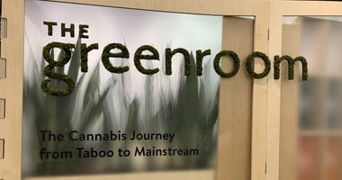 The Greenroom booth at the Philadelphia Flower Show presents information on medical marijuana.