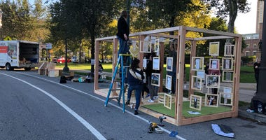 Architect Tevin Williams and companions construct a pergola on Logan Circle for Park(ing) Day PHL 2019.