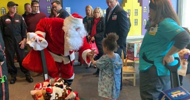 Santa visits patients at Cooper Hospital.