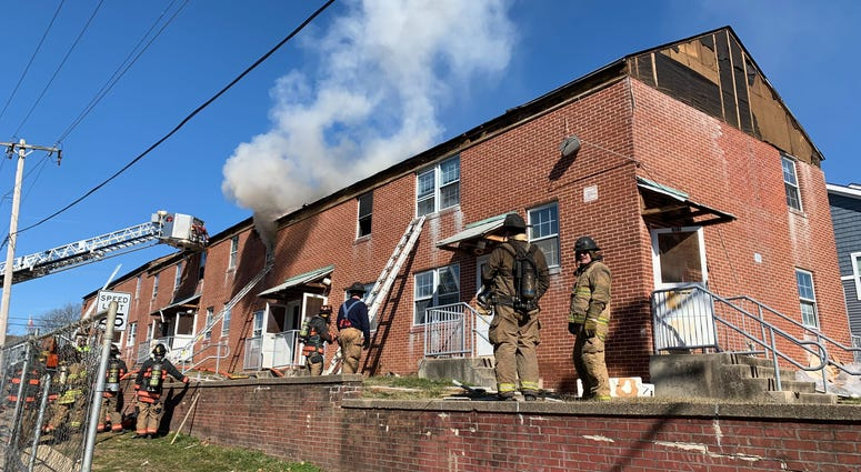 Montgomery County firefighters take part in a rare live fire training session at an eight-home complex in Upper Dublin scheduled for demolition.