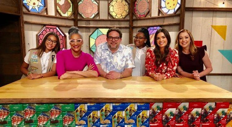 "Lindenwold's Bryana Turner (middle) on the Food Network show ""Girl Scout Cookie Championship,"" along with judges Carla Hall, Nacho Aguirre, and Katie Le, and host Alyson Hannigan."