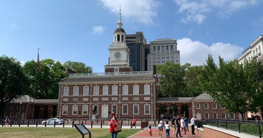 Though Independence Hall is closed to visitors, tourists still come to see it and snap photos.