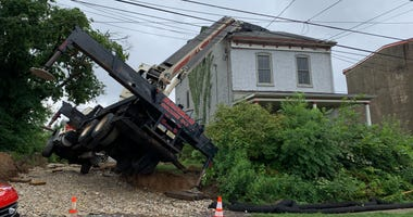 A crane toppled onto a house in Roxborough