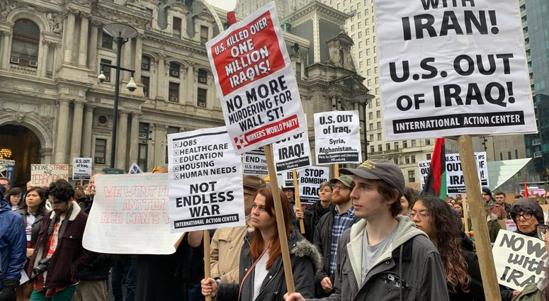 Protesters gathered at City Hall to oppose a potential war in Iran.