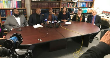Maurice Hudson at a press conference discussing getting sent to jail for not being able to pay court costs.