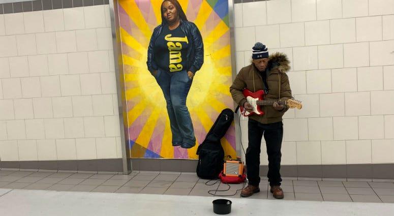 Musician Raymond de la Cruz performing at SEPTA concourse.