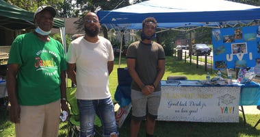 Three generations of the Koons family, among other friends and neighbors, came together to celebrate Derek Koons Jr. (right) and other graduates with a trunk party at New Hope Baptist Church in Germantown.