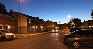 Police say five people were playing dice in the courtyard of an apartment complex on 5th Street near Carpenter Street when, just before midnight, a car pulled up and two men inside got out and shot them.