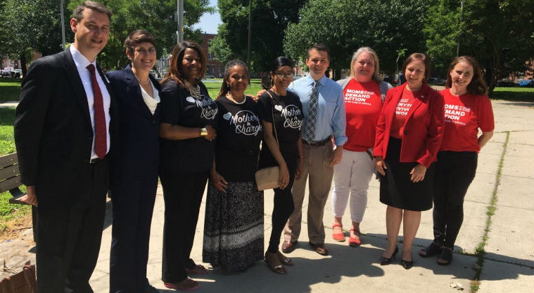 Pa. Congressman Brendan Boyle (center, in tie) in Fairhill Park with representatives from Mothers in Charge, Moms Demand Action and the Brady Campaign to Prevent Gun Violence.