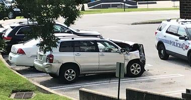 Stolen SUV slams into bus