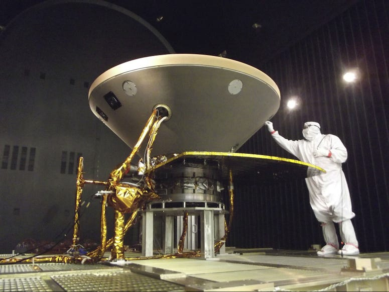 """In this 2015 photo made available by NASA, a technician prepares the InSight spacecraft for thermal vacuum testing in its """"cruise"""" configuration for its flight to Mars, simulating the conditions of outer space at Lockheed Martin Space Systems in Denver."""