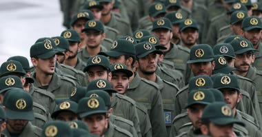 Iranian Revolutionary Guard members arrive for a ceremony celebrating the 40th anniversary of the Islamic Revolution, at the Azadi, or Freedom, Square, in Tehran, Iran.