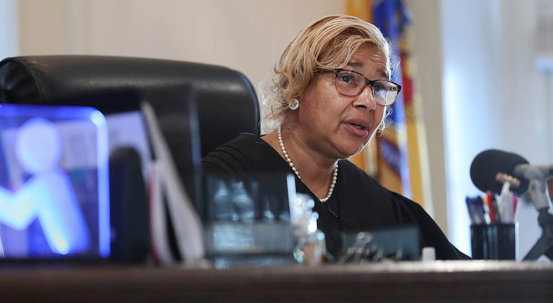 Judge Paula Dow orders depositions from all sides in the case of a homeless man who is fighting in court for the money raised on his behalf by a couple he helped last year.
