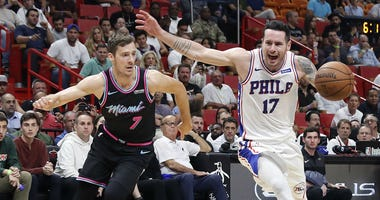 Philadelphia 76ers guard JJ Redick drives the ball to the basket against Miami Heat guard Goran Dragic in the first half of an NBA basketball game on Monday, Nov. 12, 2018, in Miami.