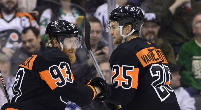 Philadelphia Flyers right wing Jakub Voracek (93) celebrates his goal with James van Riemsdyk (25) during the first period of an NHL hockey game against the Toronto Maple Leafs on Friday, March 15, 2019, in Toronto.