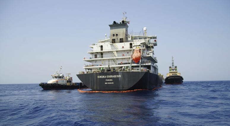 The Panama-flagged, Japanese owned oil tanker Kokuka Courageous, that the U.S. Navy says was damaged by a limpet mine, is anchored off Fujairah, United Arab Emirates, during a trip organized by the Navy for journalists, Wednesday, June 19, 2019.