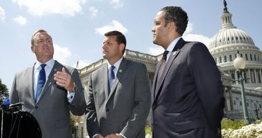 Rep. Jeff Denham, R-Calif., left, speaks next to Rep. David Valadao, R-Calif., and Rep. Will Hurd, R-Texas, during a news conference with House Republicans who are collecting signatures on a petition to force House votes on immigration legislation.