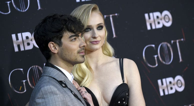 """In this April 3, 2019 file photo, Joe Jonas, left, and Sophie Turner attend HBO's """"Game of Thrones"""" final season premiere at Radio City Music Hall in New York."""