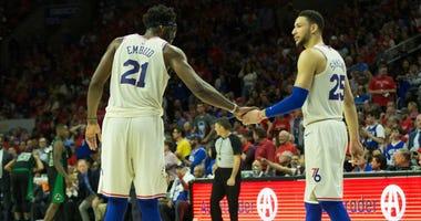Philadelphia 76ers center Joel Embiid (21) and guard Ben Simmons (25)