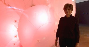 Kathryn Hiesinger, curator of decorative arts and design, in front of a giant balloon that breathes.