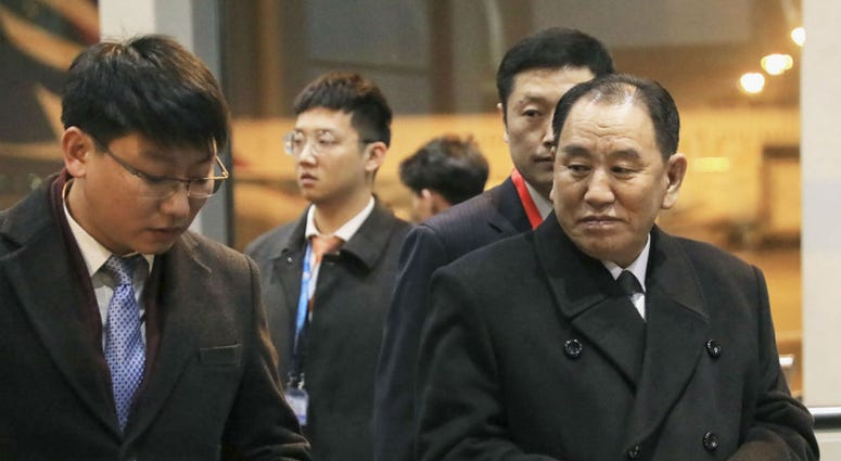 North Korean official Kim Yong Chol, right, prepares to leave the Beijing International Airport in Beijing Thursday, Jan. 17, 2019.