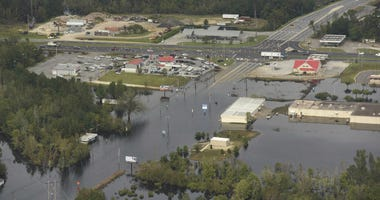 In this Monday, Sept. 24, 2018 photo, flood waters from the Neuse River cover the area a week after Hurricane Florence in Kinston, N.C. Monday Sept. 24, 2018.