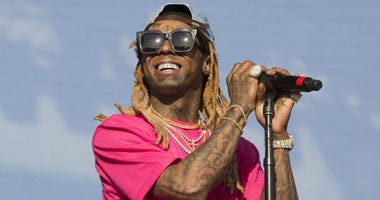 In a June 16, 2018 file photo, Lil Wayne performs on Day 3 of the 2018 Firefly Music Festival at The Woodlands, in Dover, Del.