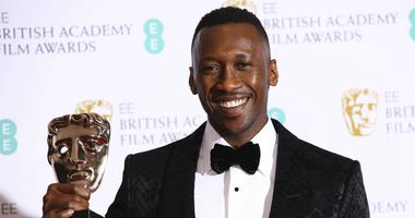 Actor Mahershala Ali poses for photographers backstage with the Best Supporting Actor award for his role in the film 'Green Book' at the BAFTA awards in London, Sunday, Feb. 10, 2019.