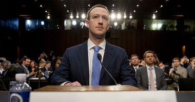 In this April 10, 2018 file photo, Facebook CEO Mark Zuckerberg arrives to testify before a joint hearing of the Commerce and Judiciary Committees on Capitol Hill in Washington about the use of Facebook data to target American voters in the 2016 election.