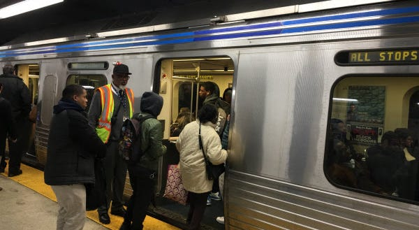 People boarding the Market Frankford Line.