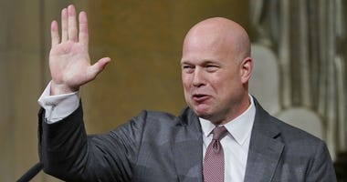 Acting Attorney General Matthew Whitaker gestures after speaking at the Dept. of Justice's Annual Veterans Appreciation Day Ceremony, Thursday, Nov. 15, 2018, at the Justice Department in Washington.